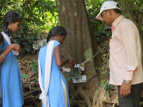 Girl students deploying the trap camera on field